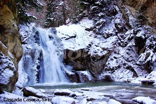 casoca waterfall in winter, buzau county, romania