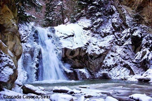 casoca waterfall in winter, buzau county, romania