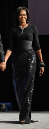 Michelle Obama wearing Michael Kors and Peter Soronen at the Congressional Black Caucus Foundation Annual Phoenix Awards at the Washington Convention Center in 2011.