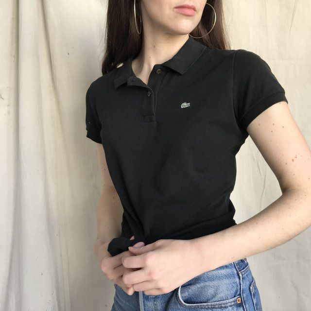 f5f8a0ab2f2ca8 Tennis vibes with this black Lacoste polo. It s 2005 again a - Depop