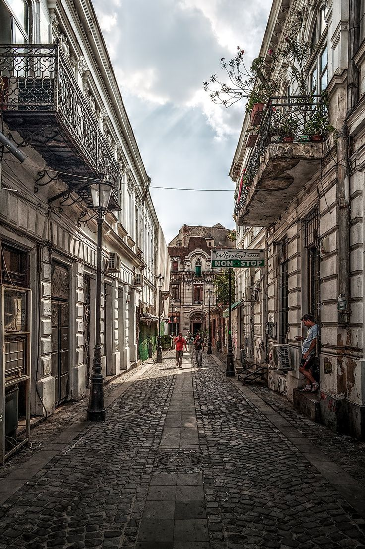 "This is a cobblestone street in the ""Old City"" part of Bucharest, Romania."