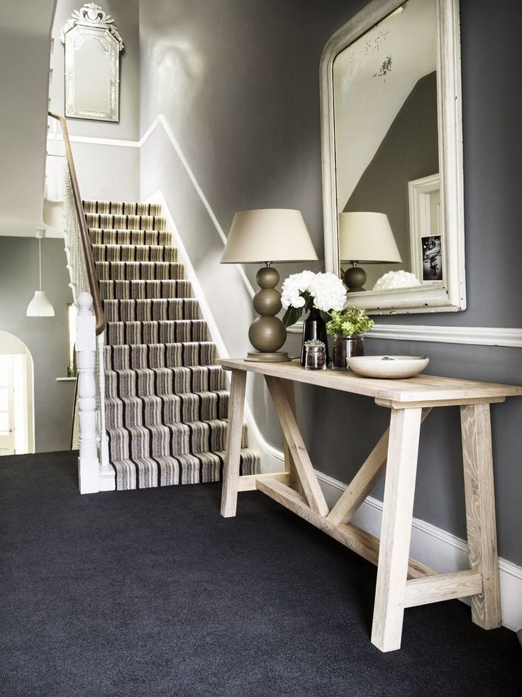 Hallway ideas: Coordinate a luxurious slate-grey carpet with a striped stair runner for a striking combination that works in both classic and modern homes. (Dimensions Heathers in Black Magic, from £29.99 a sq metre; Dimensions Heathers Black Stripe, £34.99 a sq metre; both Brockway Carpets). Find more ideas at housebeautiful.co.uk