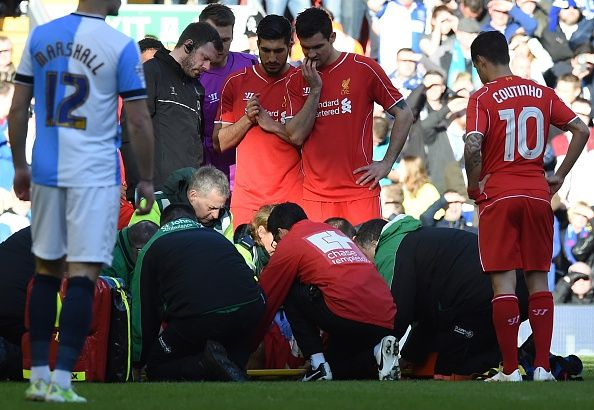 Liverpool's players look on as Liverpool's Slovakian defender Martin Skrtel is treated after a challenge with Blackburn's French-born Beninese striker Rudy Gestede (not pictured) during FA Cup quarter-final match between Liverpool and Blackburn Rovers at Anfield in Liverpool, north west England on March 8, 2015
