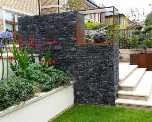 Bespoke garden planters using a corten frame and slate stone cladding.