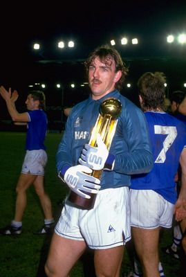 Here's legendary Everton goalkeeper Neville Southall holding the 1985 European Cup Winners' Cup. He looks shell-shocked, but his mustache is calm and composed. www.theevertonforum.com