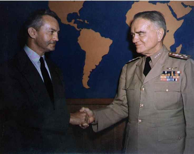 Secretary of the US Navy James Forrestal shaking hands with Admiral William Halsey, probably at the Navy Department, Washington DC, United States, circa summer 1944.