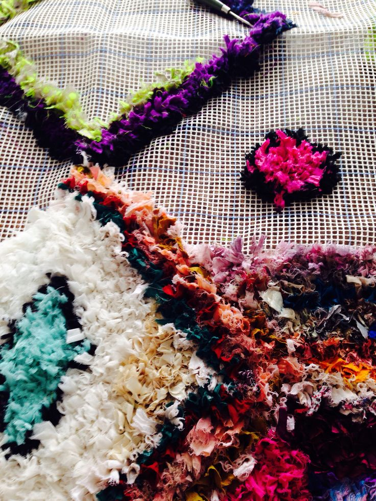 DIY modified boucherouite rug in the making. Using old clothing and sari scraps.