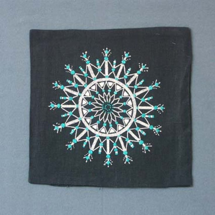 "Kuddvar ""Kristall"" med broderi i flera olika tekniker på svart linnetyg. Design: Irma Kronlund"