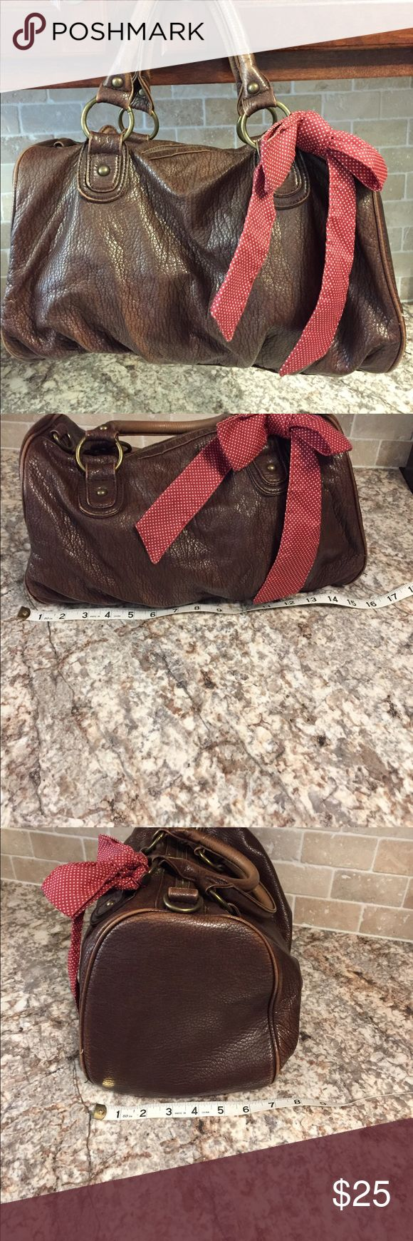 American eagle AE brown leather handbag. Super soft leather handbag from AE.  The color is a deep chocolate brown, bronze hardware. The interior is red polka dot and there is a matching (removal) bow on the handle. Excellent condition American Eagle Outfitters Bags
