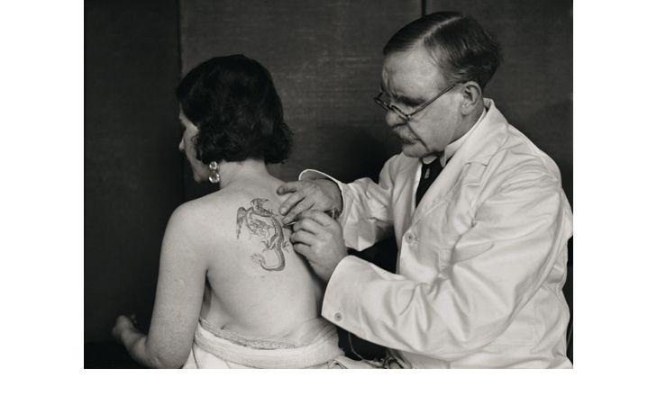 George Burchett Tattooing a Woman's Back, Waterloo Road, London 1931