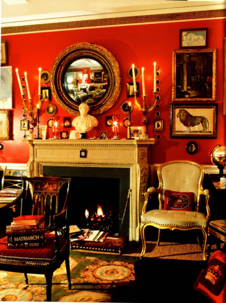 Red Walls In A Traditional But Eclectic Room A Lot Going