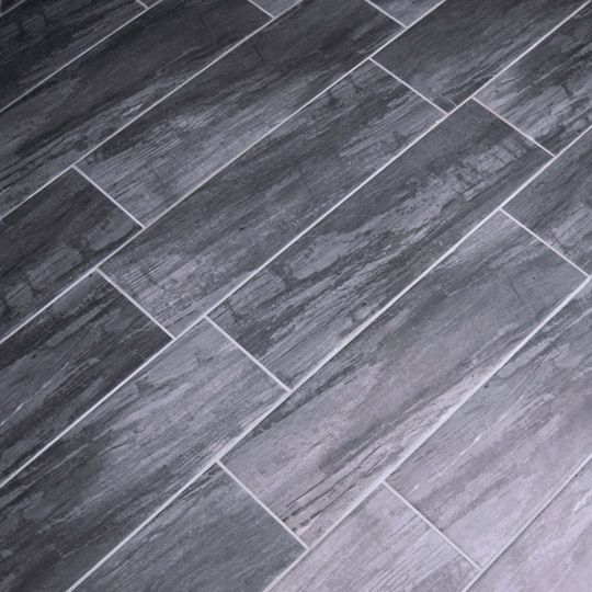 Metre square rustic wood effect dark grey is a for Grey brown floor tiles