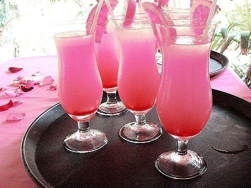 Barbie Doll Cocktail 1 oz Malibu Rum 3 oz Pineapple Juice 1 oz Raspberry Sour Puss 3 oz Sprite/7Up Serve with strawberry