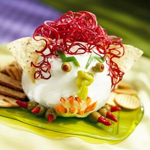 Cheesy Goblin Head The taco-flavored cheese spreads easily on crackers for a quick snack or Halloween party appetizer.