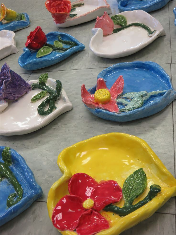 """Steiner Ranch Elementary 4th grader ceramic heart shaped dishes with roses and flowers, approx. 6""""--8"""" wide; art teacher: Susan Joe"""