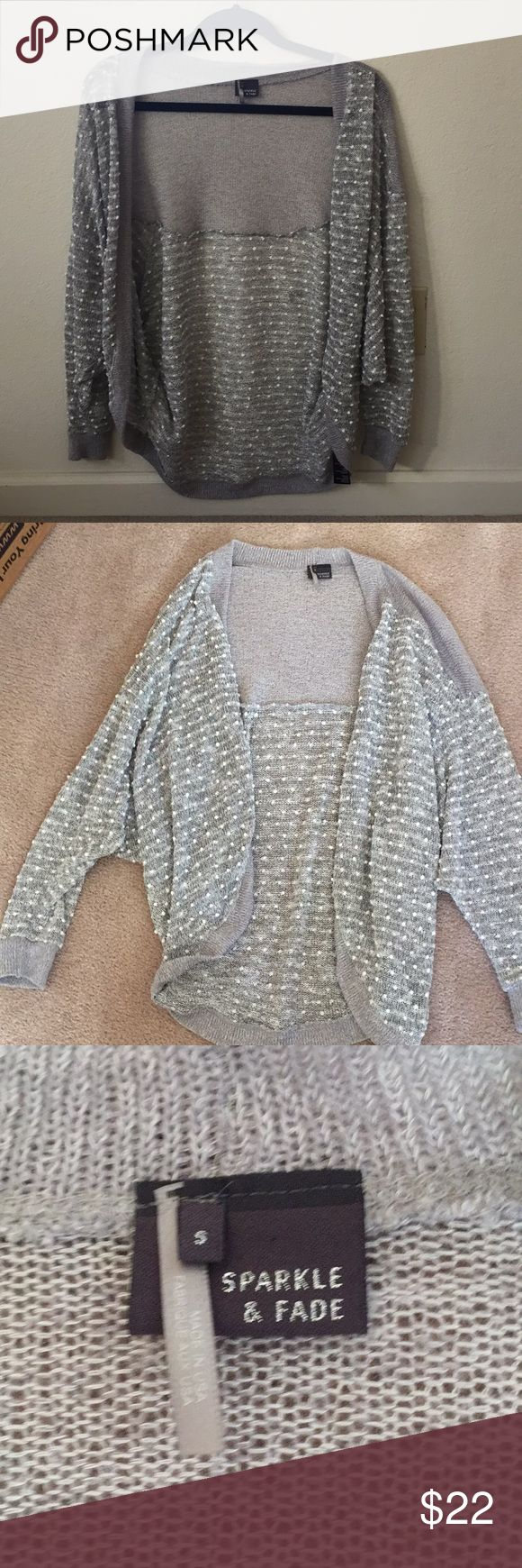 Sparkle and fade dotted cardigan! Urban outfitters brand sparkle and fade polka dotted cardigan! Worn only a few times and like new. Only one small unraveling of the fabric on the inside, but not noticeable and not affected the outside of the cardigan Urban Outfitters Sweaters Cardigans