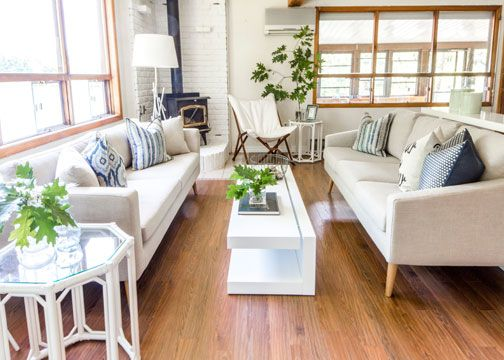 A serene and bright cottage decorated with neutrals and whites using our Danny sofa, Regeant side table and Draper chair. Find them on www.mirens.com