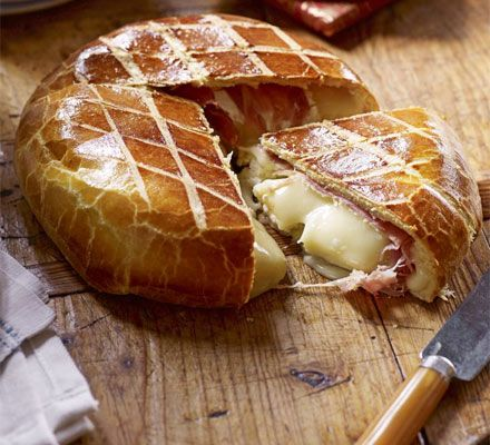 Brie wrapped in prosciutto & brioche  This decadent bake from Paul Hollywood combines slightly sweet French bread with a creamy ham and cheese filling