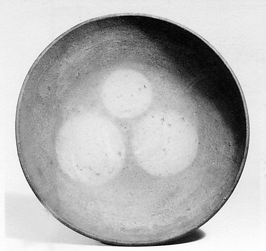 Dish with Three Circular Designs  Kitaoji Rosanjin  (1883–1959)  This plate is inspired by Bizen ware, characterized by its hard red earthenware body, lack of glaze, and the accidental surface effects that occurred during firing in woodburning kilns.