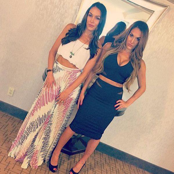 "Double Trouble from The Bella Twins' Sexiest Pics ""Double Trouble #elizabethandjames #aliceandolivia #doubletrouble #TeamBella #honeybglam @thebriebella @honeybeileen"" —Nikki Bella"