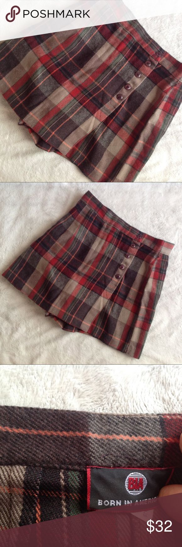 Vintage 90s Plaid Mini Skort Schoolgirl Great vintage condition. Skort (shorts under a skirt) in soft plaid with button front. Red, green, black and beige plaid. Zipper on shorts underneath skirt flap. Brand in Born in America BIA. Likely circa mid 90s based on style and manufacturer tag. Made in USA. Size tag says 7/8 but listed as small based on measurements & fit, see photos. Vintage Skirts