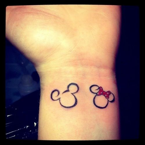 Maybe a cute couple tattoo. Mickey for him, Minnie for her.