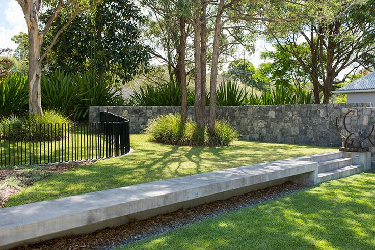 Natural beauty. Coastal Garden north of Sydney designed by Secret Gardens. Love the contrast between the stone wall and whimsical fencing.