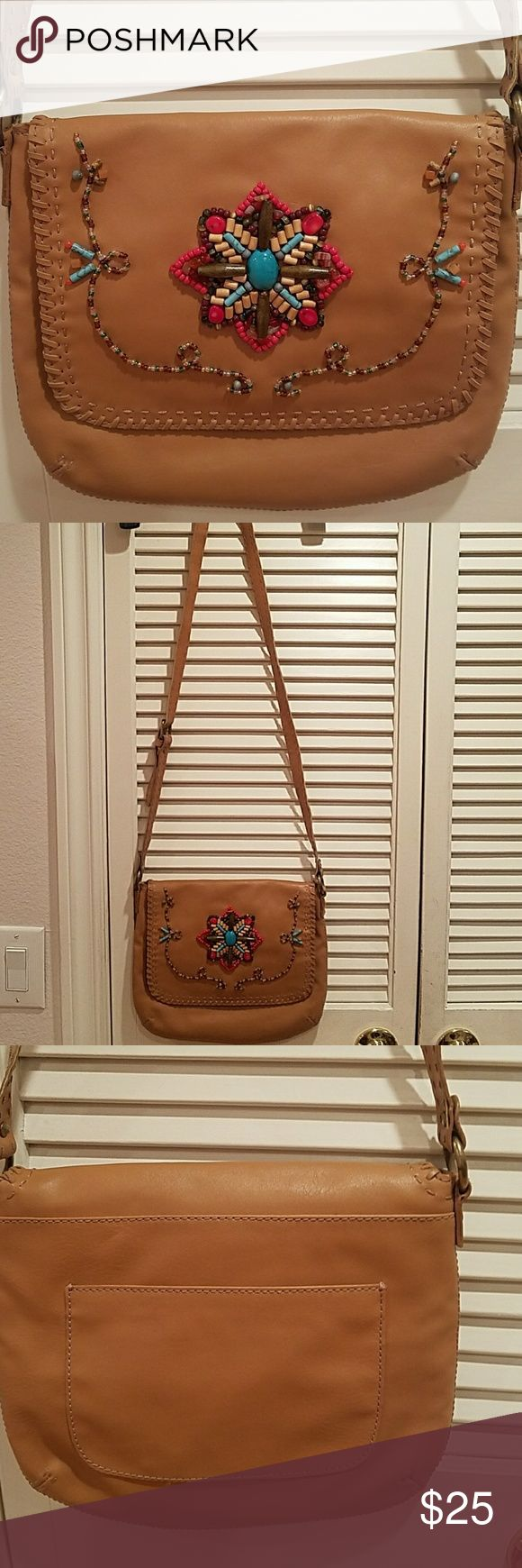 """Nine West Boho Faux leather crossbody bag Excellent pre-owned condition Beaded front detail 1 pocket on back Snap button closure Faux leather for easy cleaning 3 credit card slots inside 1 zip pocket  And 1 small open pocket  11 x 8 1/2"""" Strap drop is 22"""" Perfect for festivals Nine West Bags Crossbody Bags"""