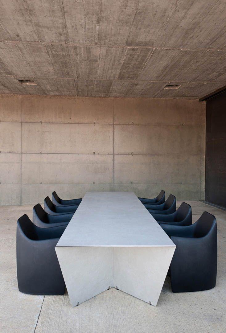 Concrete walls + ANGLE table, designed by Serra y de la Rocha, Barcelona, Catalonia