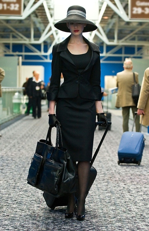 Classic retro Dior look. Devil Wears Prada. . . now Batman! How did her character in Batman end up so fashionable and chic?!?
