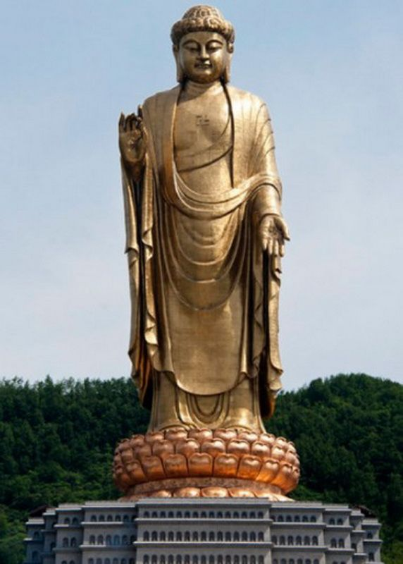 128 meters statue of buddha of Buddha Temple in Spring County Lusha China is the highest in the world. The statue, completed in 2002, is in the building of Buddhist monastery. (Zgpdszz)