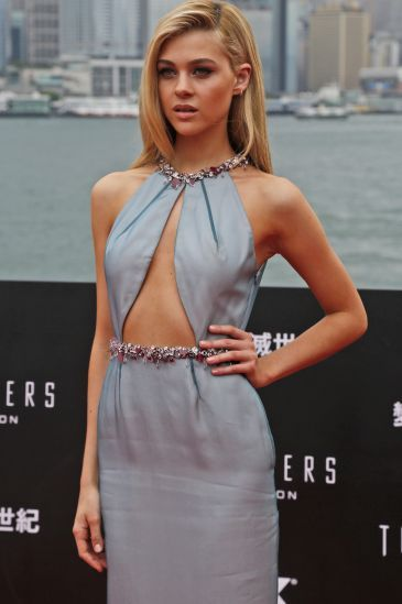 """American actress Nicola Peltz poses on the red carpet as she arrives for the World Premiere of the movie """"Transformers 4: Age of Extinction"""" in Hong Kong"""