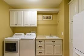Laundry room - rail over tub, cupboards over w/d (but we have window) Reverse layout!