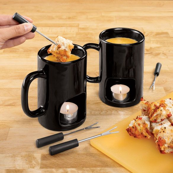 Easy fondue at home! Melt cheese or chocolate for dipping fruit, veggies, breads and more. Ceramic personal fondue mugs feature bottom openings for tea lights (not included) to heat your favorite dip. Set of 2 mugs and 4 dipping forks. Microwave and dishwasher safe. Mugs measure 3L x 5W x 4 3/4H. Forks are 4 5/8L. Fondue Mugs $7.50