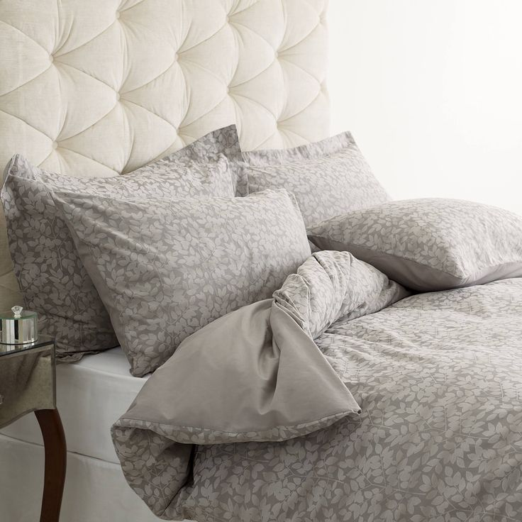 Love this Laura Ashley bedding and statement headboard!