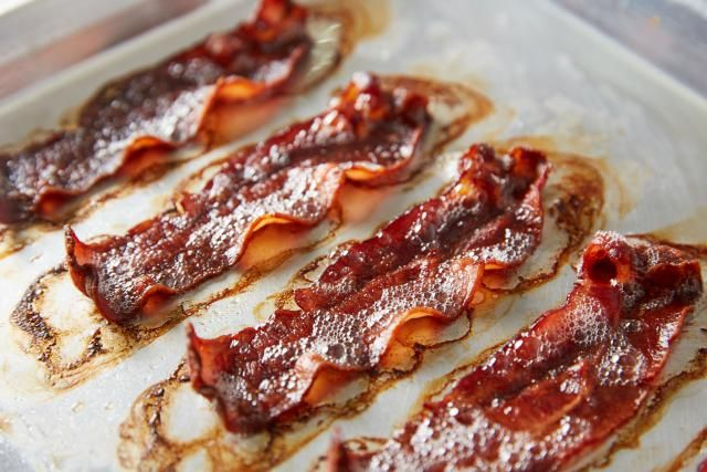 Oven-cooked bacon is a perfect way to avoid bacon messes in the kitchen! It's so easy and cooks up in no time!