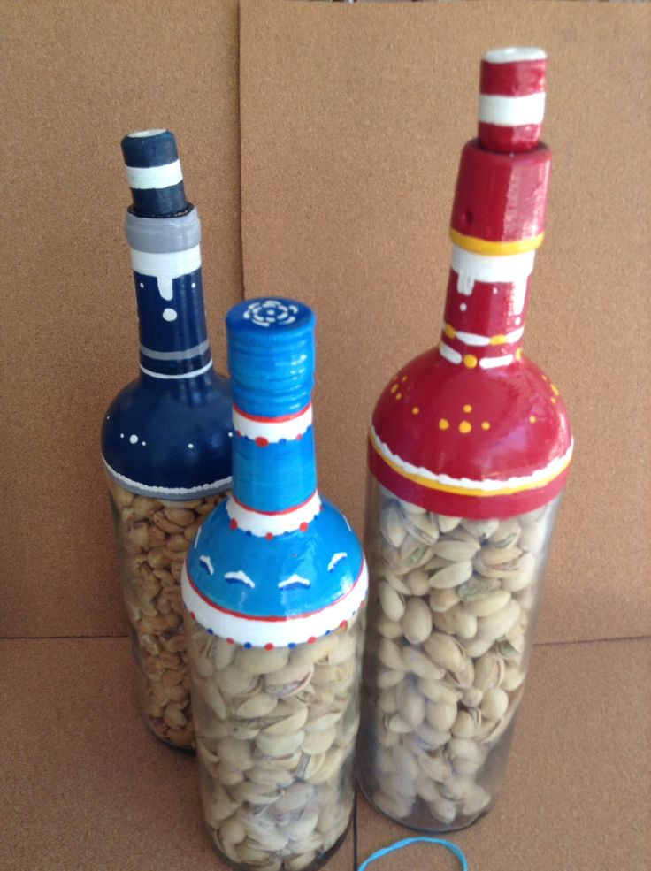 Hand painted wine or liquor bottles. Eat the nuts while you cheer your team. Cowboys, dolphins, redskins. These were made for Gary to share with the women in his life.