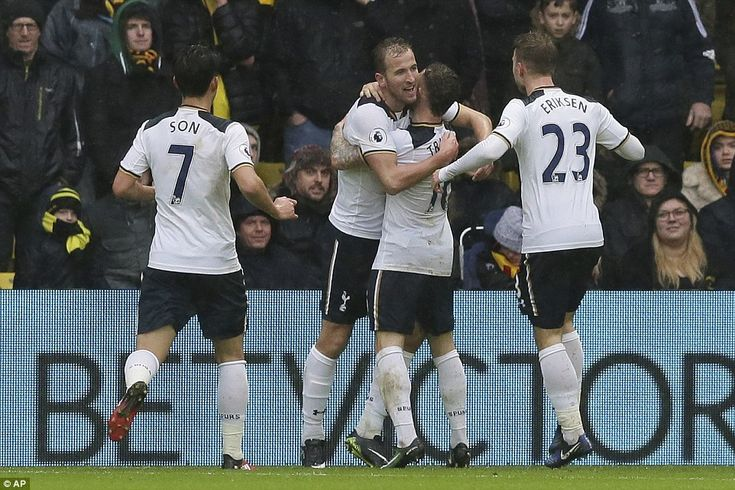 Kane hugs Kieran Trippier after celebrating the first of his goals at Vicarage Road ...