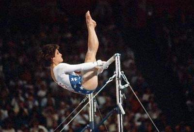 Mary Lou Retton (born: 1968)    1984: Became the first American gymnast to win Olympic gold  The spunky gymnast sprung into fans' hearts in 1984 when she nailed a perfect 10 on the vault to take home the all-around title at the Olympics. With her memorable performance, Retton became the first American woman to win Olympic gold in gymnastics.