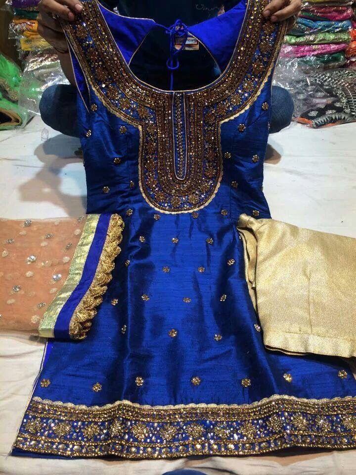Royal blue and gold salwar kameez by Madaan Cloth House Phagwara.