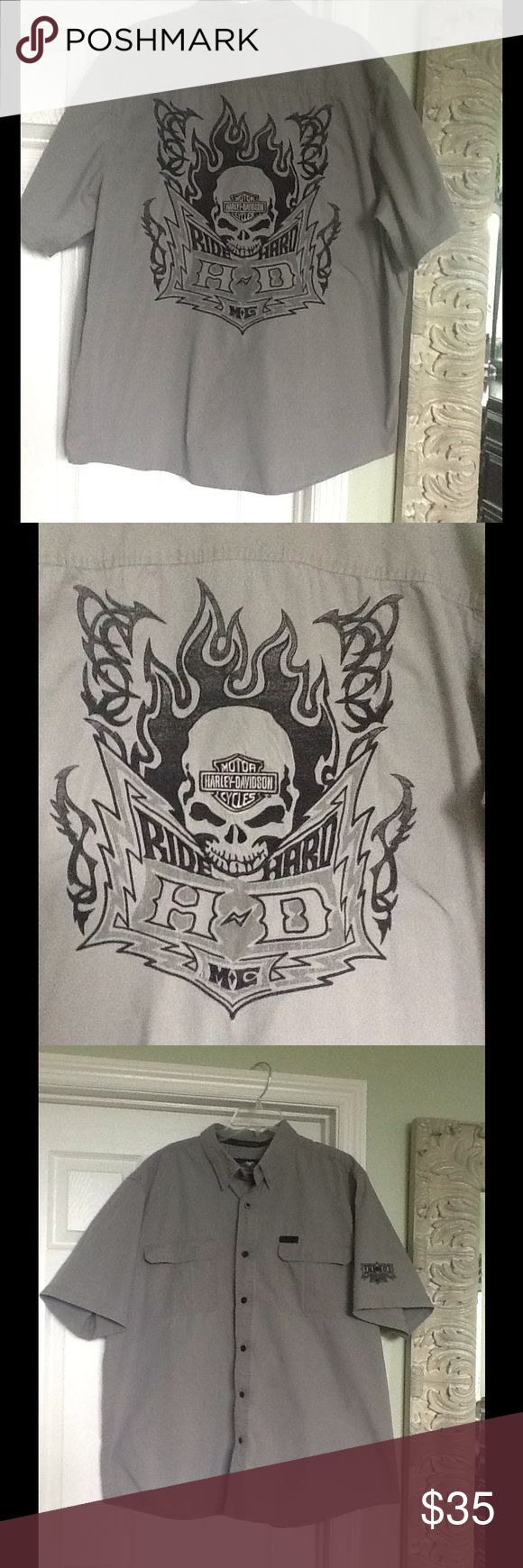 Harley Davidson Skull Button Down Gray w black HD skull design on back.  Size XXL.  Snap front pockets and collar.  7 buttons down front w 2 xtras sewn in bottom underside.  Small light blue stain under left pocket- last pic. Harley-Davidson Shirts Casual Button Down Shirts