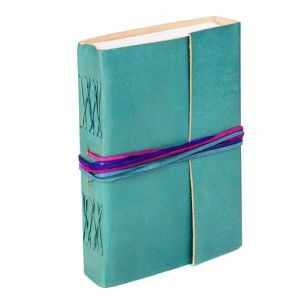 This bright turquoise leather bound journal is filled with 115 pages of eco friendly paper made with recycled unbleached cotton leftover from the massive garment industry in India.The slightly textured pages are lovely to write on with ballpoint or gel pens, and the hard wearing leather cover keeps the pages safe for a long time. The journal closes with contrast ties in purple, blue and pink. It's an ideal as a gift for anyone who loves writing or drawing, or to fill with messages from…