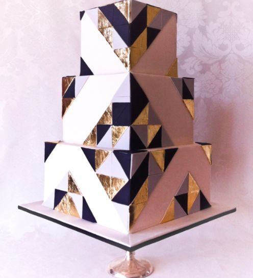 Gold, black, and white art deco-themed cake via Yummy Cupcakes and Cakes (http://www.yummycupcakes.com.au/)