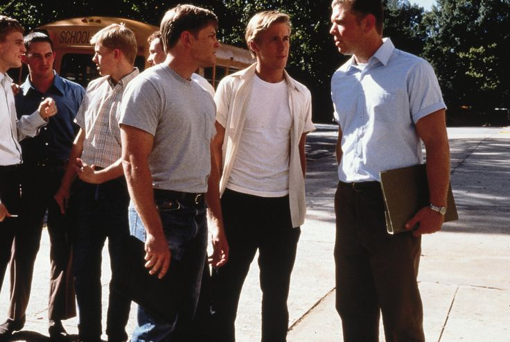 """Remember The Titans"" movie still, 2000.  L to R: Burgess Jenkins, Ryan Gosling, Ryan Hurst."