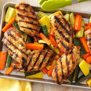 APPLE-MARINATED CHICKEN   ~  1 c. apple juice...1/2 c. canola oil...1/4 c. packed brown sugar...1/4 c. low-sodium soy sauce...3 T. lemon juice...2 T. minced fresh parsley...3 cloves garlic, minced...6 boneless skinless chicken breast halves ...4 large carrots...2 med. zucchini...2 med. yellow summer squash