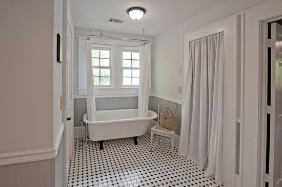 Here is another patterned tile floor with actual wainscoting. Wainscoting can be made of vinyl, so we wouldn't need to paint it and it would stand up to water.