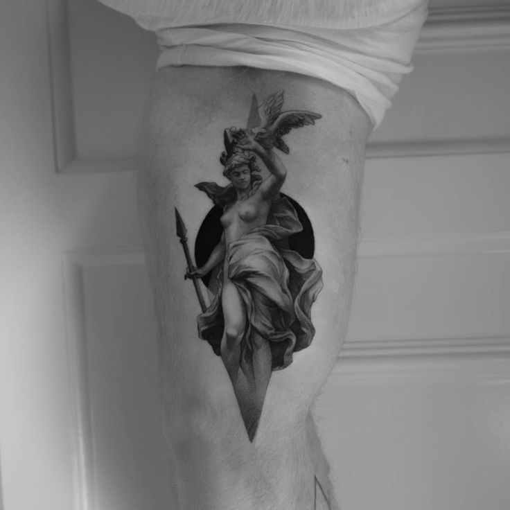 Athena tattoo on the inner arm.