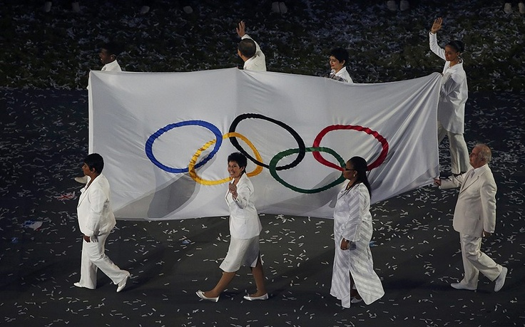 London 2012 Olympics: Lighting the Olympic Flame - The Olympic flag is carried by 6 special representatives during the opening ceremony of the London 2012 Olympic Games  Picture: REUTERS