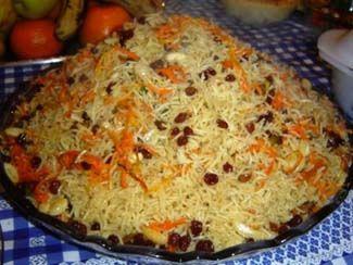 Kabuli Pulao or Afghan Rice Pilaf (basmati rice, carrots, raisins, and lamb or beef).