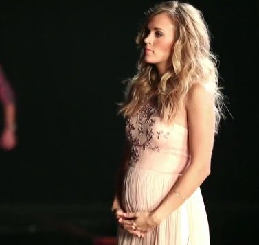 I accidentally came across this picture looking for something else. #stunning #carrieunderwood #babybump